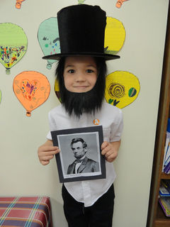 A Community Christian Academy student presents Abraham Lincoln